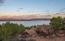 Sunset over Abiquiu Lake in Northern New Mexico. View of Abiquiu Lake and the mountains in northern New Mexico as seen from above the campground stock photo