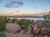 Sunset over Abiquiu Lake in Northern New Mexico. View of Abiquiu Lake and the mountains in northern New Mexico as seen from above the campground stock image
