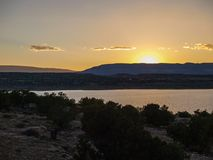 Sunset over Abiquiu Lake in Northern New Mexico. View of Abiquiu Lake and the mountains in northern New Mexico as seen from above the campground royalty free stock images