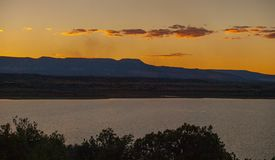 Sunset over Abiquiu Lake in Northern New Mexico. View of Abiquiu Lake and the mountains in northern New Mexico as seen from above the campground royalty free stock photography