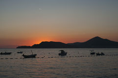 Sunset over the Adriatic Sea. The beach next to the Sveti Stefan, Montenegro Stock Photography