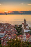 Sunset Over Adriatic Sea and Old Town of Piran, Slovenia Stock Photo