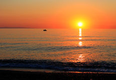 Sunset over the Aegean Sea. Sunset over the Aegean sea with two fishermen on boat. HDR image Stock Photography