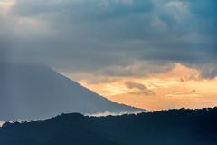 Sunset over Agua volcano, Antigua, Guatemala. Sunset over slopes of Agua volcano near Spanish colonial town & UNESCO World Heritage Site of Antigua in Panchoy stock images