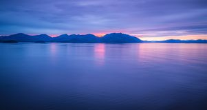 Sunset over alaska fjords on a cruise trip near ketchikan Royalty Free Stock Image