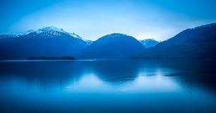 Sunset over alaska fjords on a cruise trip near ketchikan Royalty Free Stock Photos