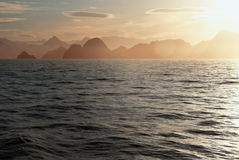 Sunset over the alaskan coastline. Royalty Free Stock Photos