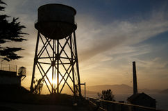 Sunset over Alcatraz. Photograph of the watertower on Alcatraz island in San Francisco Bay Royalty Free Stock Photo