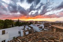 Sunset over Alcudia`s rooftops Stock Images