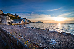 Sunset over Alesund beach. Scenic view of colorful sunset over Alesund town and beach with blue sky and cloudscape background, Norway Stock Image