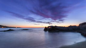 Sunset over Algajola beach in Corsica Stock Photos