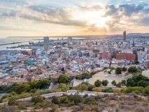 Sunset over Alicante, view of the city skyline, bay and sea.. Royalty Free Stock Photos