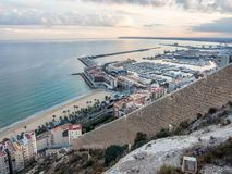 Sunset over Alicante, view of the city skyline, bay and sea.. Royalty Free Stock Photography