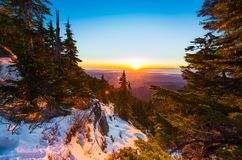 Sunset over alpine forest Royalty Free Stock Images