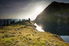 Sunset over alpine lake and mountain peaks. Germany Stock Photography