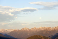 Sunset over the Alps with full moon Royalty Free Stock Photo