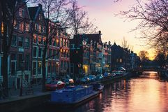 Sunset over Amsterdam, Netherlands canals and Royalty Free Stock Images