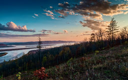 Sunset over the Amur river in late autumn. Royalty Free Stock Photography