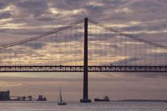Sunset over the 25 of April Bridge in Lisbon royalty free stock photos