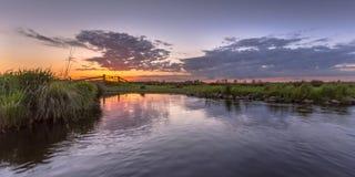 Sunset over aquatic farmland Stock Photo