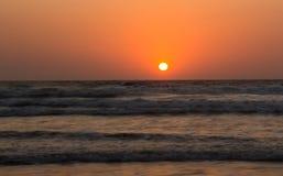 Sunset over Arabian sea, Indian ocean, on Arambol beach, Goa, In Stock Photo