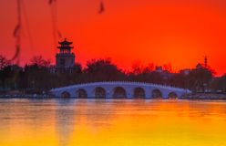 Sunset over 7-Arch Bridge. In Tianjin, China. After the sun disappeared Stock Photo