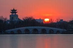 Sunset over 7-Arch Bridge. In Tianjin, China. Shot it several times, but always with lens flare. This time, I think it Ok Stock Photo