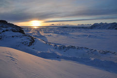 Sunset over Arctic landscape, Greenland. Arctic landscape during winter, Greenland, panorama Royalty Free Stock Images