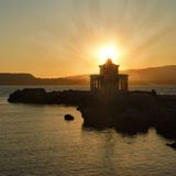 Sunset over Argostoli Lighthouse on Cephalonia Royalty Free Stock Photography