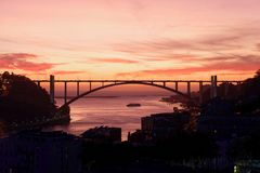 Sunset over Arrabida Bridge in Porto, Portugal Royalty Free Stock Photo