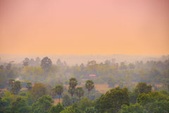 Sunset over asian town and jungle Stock Images