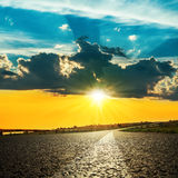 Sunset over asphalt road Royalty Free Stock Photography