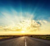 Sunset over asphalt road Royalty Free Stock Photo