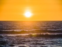 Sunset over the Atlantic on Gale Beach. Sunset over the Atlantic on the beach at Gale on the southern Portuguese coast of the Atlantic Royalty Free Stock Photo