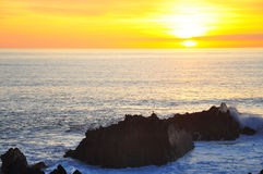 Sunset over Atlantic Ocean, Hartland Quay, Devon Stock Images
