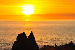 Sunset over Atlantic Ocean, Hartland Quay, Devon, England Royalty Free Stock Images