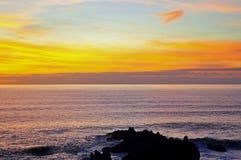 Sunset over Atlantic Ocean, Hartland Quay, Devon, England Stock Images