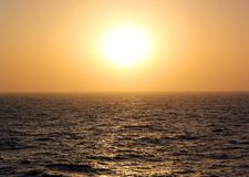 Sunset in the open sea stock photo