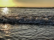 Sunset over the Atlantic Ocean from sand beach in Agadir, Morocco, Africa stock image