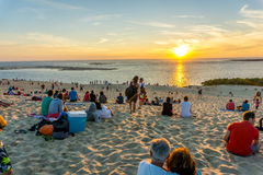 Sunset Over Atlantic. People on the Pilat Dune in France watching the sunset on a summer evening Stock Image