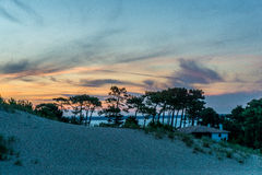 Sunset Over Atlantic. Scenic sunset over the Atlantic from a high Dune in France Stock Photo