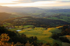 Panoramic view hilly landscape at coast by sunset Royalty Free Stock Photography