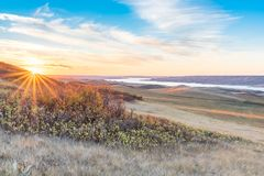 Sunset over autumn leaves on a hillside overlooking Lake Diefenbaker stock images