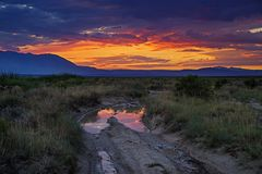 Sunset And Dirt Road Royalty Free Stock Photo