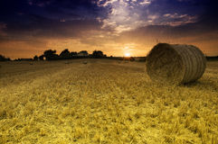 Sunset over bails of hay Stock Photo