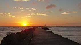 Sunset over the Baltic sea with breakwater in front Stock Image