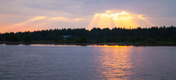 Sunset over Baltic Sea coast, sunbeams Royalty Free Stock Photography