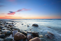 Sunset over the Baltic sea. The pebbly beach in Rozewie Stock Images