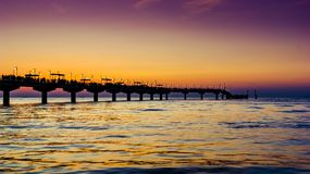 Sunset over baltic sea and pier Royalty Free Stock Images