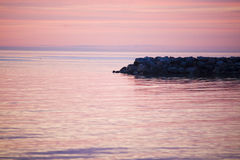 Sunset over the Balticsea.GN. Sunset over the balticsea whit a stone pier in the foreground.GN royalty free stock photography